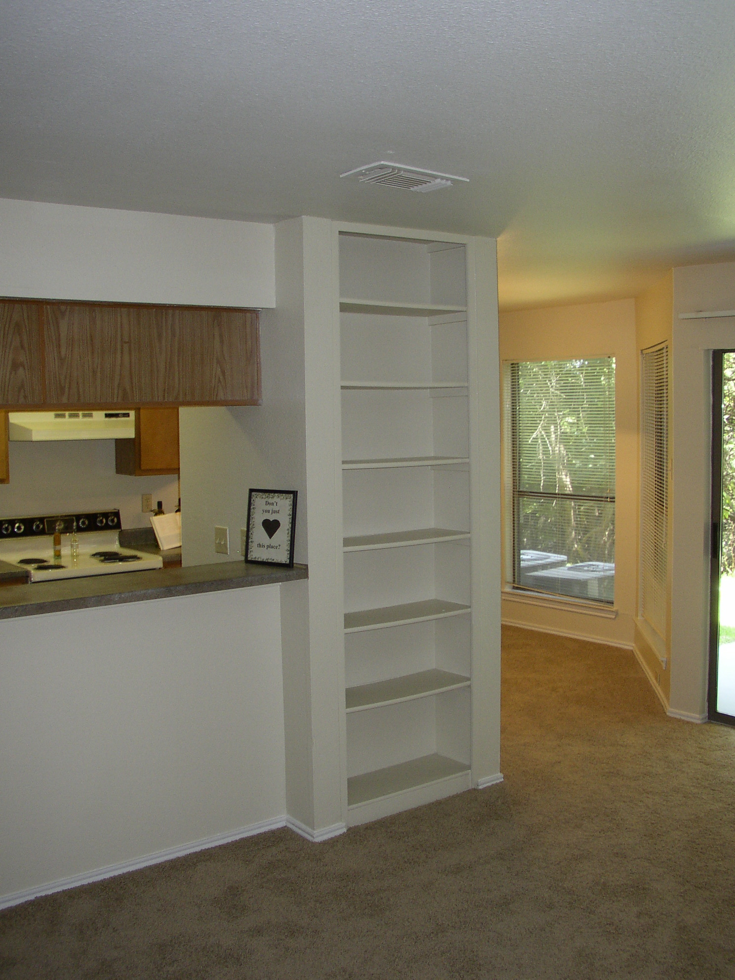 Kitchen,book shelves,dining room